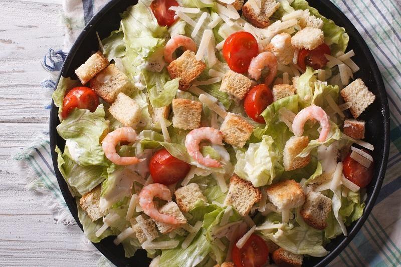 caesar-salad-with-shrimps-horizontal-top-view-closeup