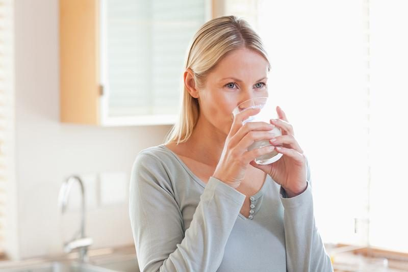 woman-in-the-kitchen-drinking-water
