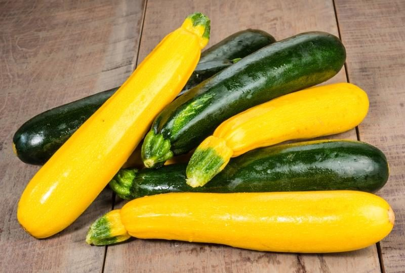 zucchini-and-yellow-squash-displayed-on-a-wooden-table
