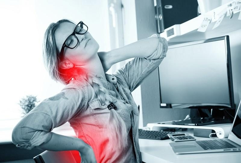 woman-in-home-office-suffering-from-backache-sitting-at-computer-desk