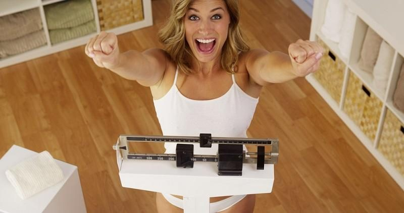 happy-woman-celebrating-weight-loss-2