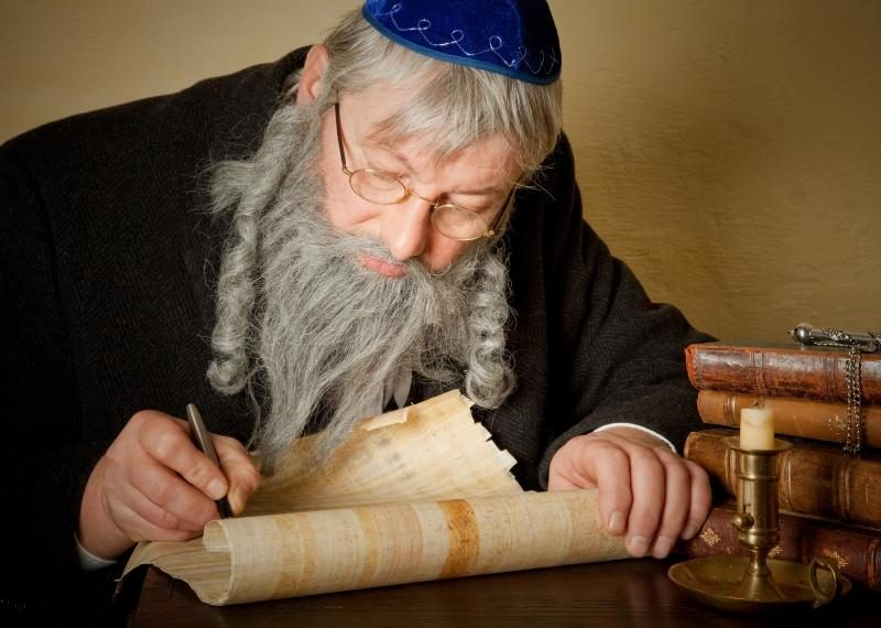 old-jewish-man-with-beard-writing-on-a-parchment-scroll