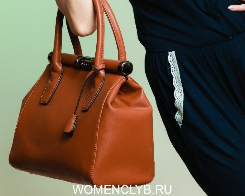 stylish-woman-fashion-girl-holding-brown-handbag