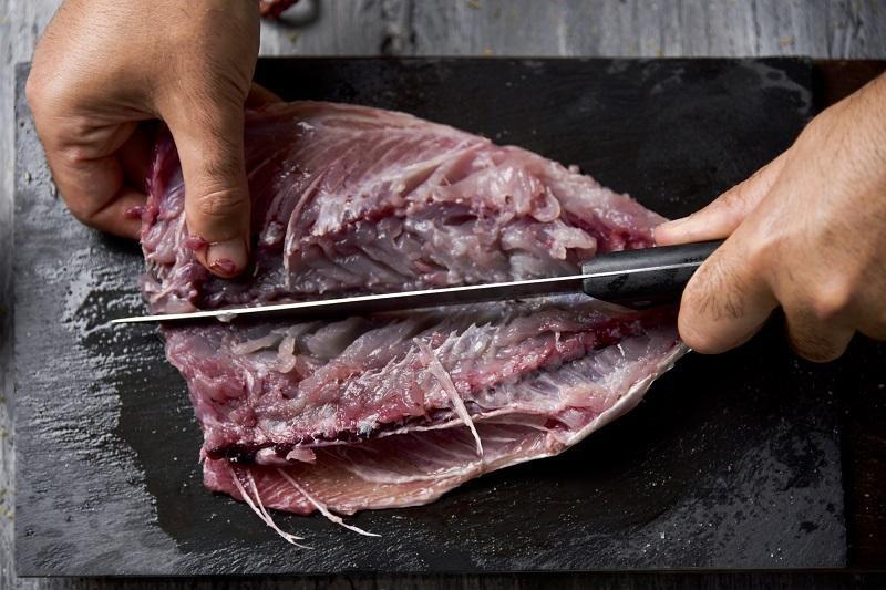 young-man-cutting-a-fresh-mackerel