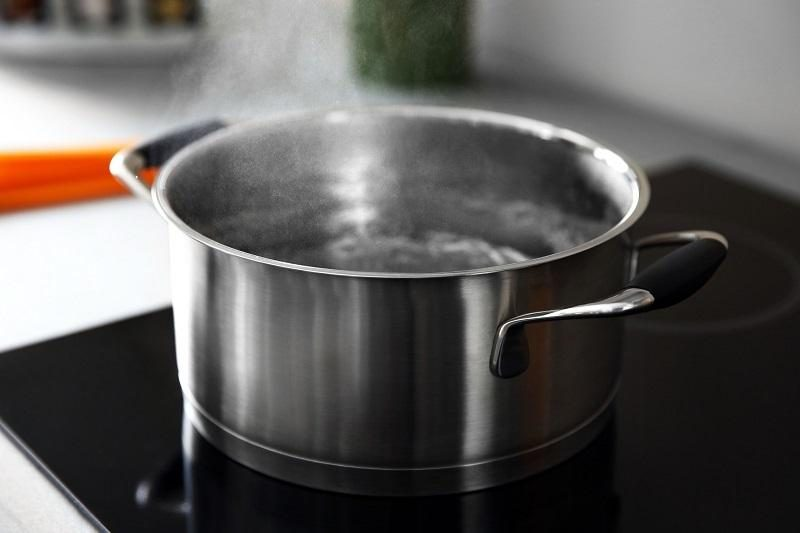 boiling-water-in-pan-on-electric-stove-in-the-kitchen