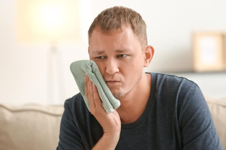man-suffering-from-toothache-at-home
