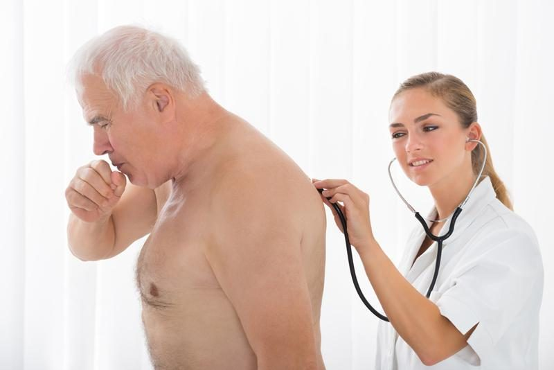 doctor-using-stethoscope-on-patients-back