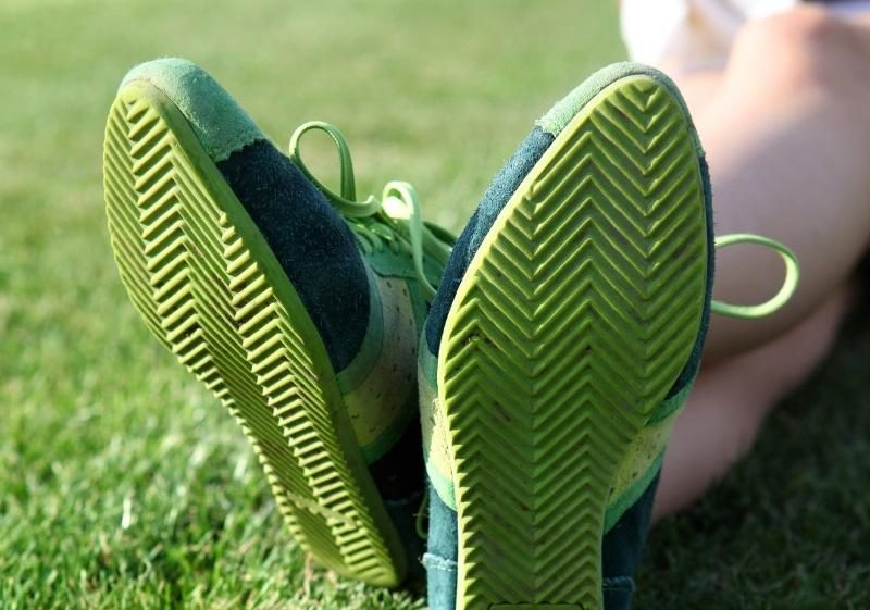 green-sole-of-shoes-on-grass-gymnastics