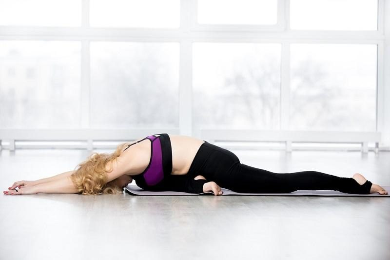 senior-woman-doing-sleeping-swan-yoga-pose