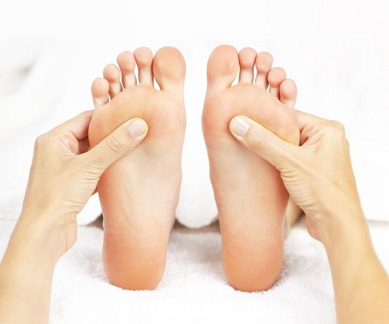 female-hands-giving-massage-to-soft-bare-feet
