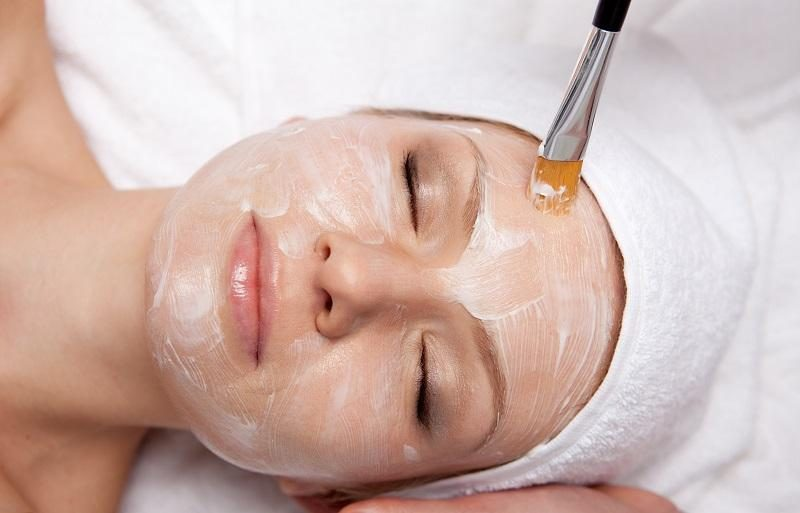 spa-therapy-for-woman-receiving-facial-mask-at-beauty-salon