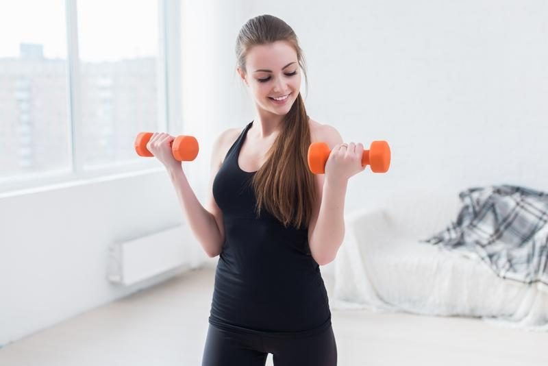 active-sportive-athletic-woman-with-dumbbells-pumping-up-muscles-biceps-concept-fitness-sport-training-lifestyle