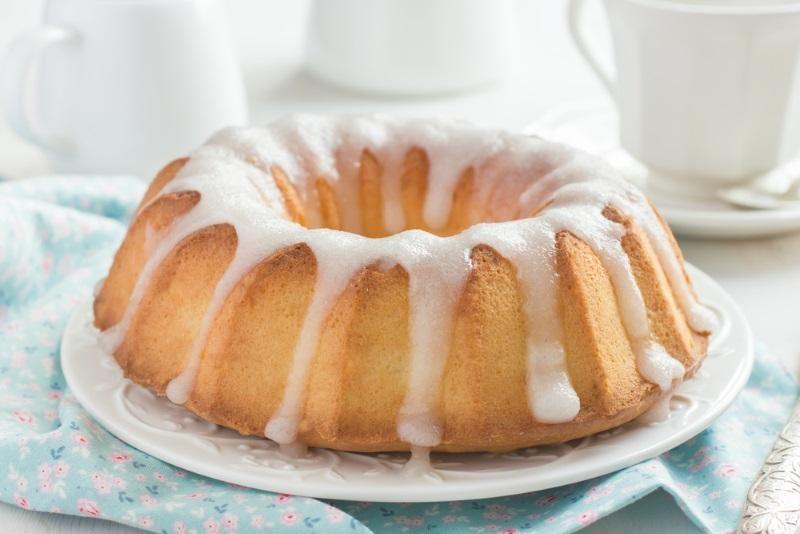 bundt-cake-with-sugar-glaze-on-white-background