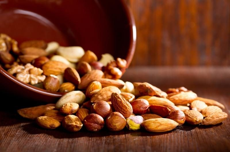 mix-nuts-on-a-wooden-table