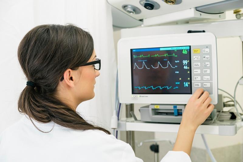 medical-doctor-making-ecg-test-in-hospital