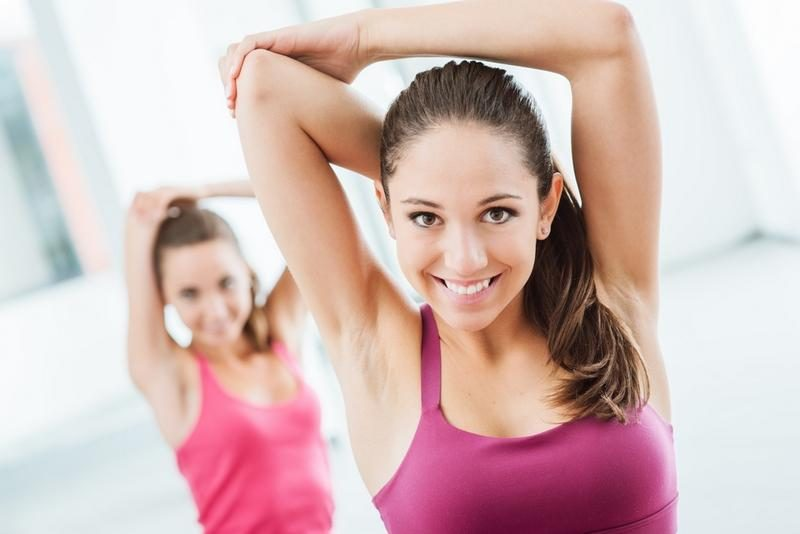girls-doing-stretching-exercises-at-the-gym